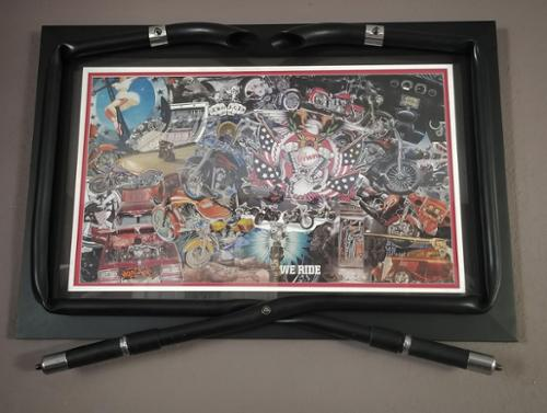 "The most popular piece in the MagChop collection is the Motorcycle themed ""Iron Freedom"" It is custom framed with actual handles from a Harley Davidson Motorcycle. This piece can be found on Buffs, leggings, swimwear, mugs, and as a giclee. It has been featured in the most prestigious galleries."